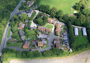 Ketchers Farm. The original farmhouse can be seen at the top, and the Recreation ground is immediately north of the development. 126